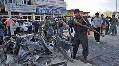 Afghan police were left to pick up the pieces after a devastating series of Taliban attacks across the country [AFP]
