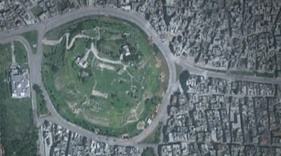 Satellite images show ruined deserted Homs