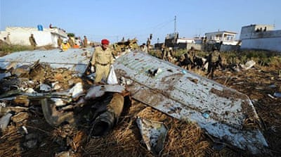 Rescue workers and local residents search the site of the plane crash near Islamabad's international airport [AFP]