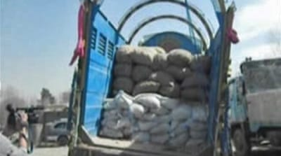 The explosive materials were hidden under potato bags in a truck coming from Pakistan, officials said