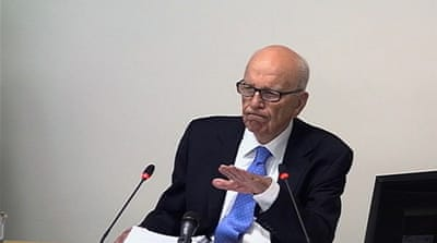 Murdoch admits 'cover-up' over phone hacking