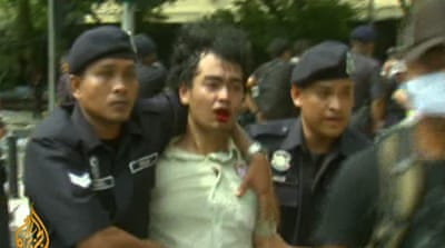 Malaysian protesters beaten by riot police