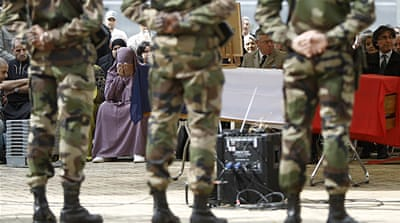 The military funeral for Mohamed Legouad, a Muslim paratrooper murdered by Merah, at a mosque in Lyon [AP]