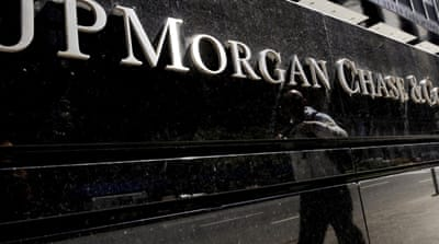 Two charged in JPMorgan trading-loss case