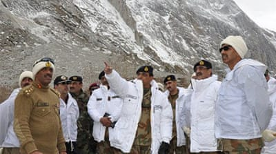 Army chief Kayani, at right, inspected the search-and-rescue operations near the avalanche site on Sunday [Reuters]