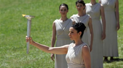 The Olympic flame was kindled by a 'high priestess', in ancient Greek costume, who captured the sun's rays in a concave mirror [GETTY]