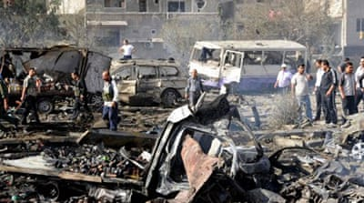 Dozens dead in twin Damascus blasts