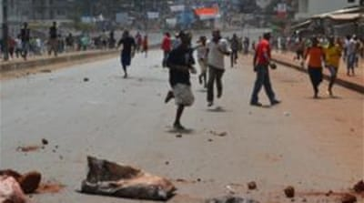 Supporters of a Guinean opposition  party clashed with police as they protested against President Alpha Conde [AFP]