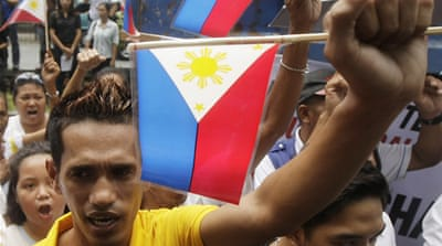 Hundreds of Filipinos rallied outside the Chinese Embassy to protest alleged bullying of the Philippines [EPA]