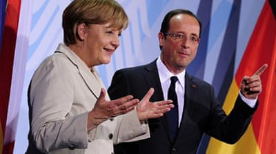 Hollande vows to work with Merkel