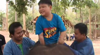 Elephants help treat autism in Thailand