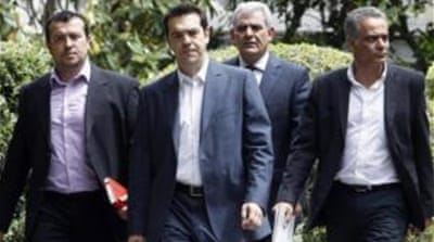 President Karolos Papoulias, right, has given Alexis Tsipras, left, three days to form a coalition government [EPA]
