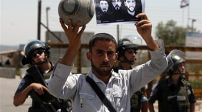 Protesters gather in front of Ofer prison, near Ramallah, in solidarity with the three footballers held by Israel [AFP]