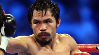 The WBO completed its review of the controversial split-decision victory with its five-member judging panel all scoring the fight for Pacquiao [AFP]