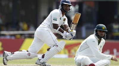 Cutting it fine: Kumar Sangakkara dives to complete his Test ton as Sri Lanka steer themselves into a comfortable position on the opening day [Reuters]