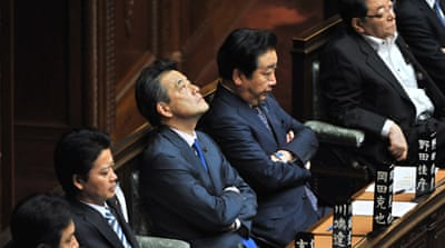 Japan PM wins crucial vote to raise sales tax