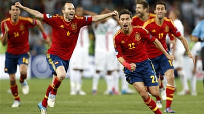 Gerard Pique of Spain scores from the spot as Spain finally claim victory after 120 minutes of goalless football [EPA]