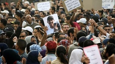Moroccan demonstrators held signs protesting against the arrest of rapper El Haked in November 2011 [AP]