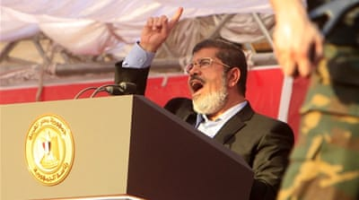 Egypt's Morsi defies military in fiery speech