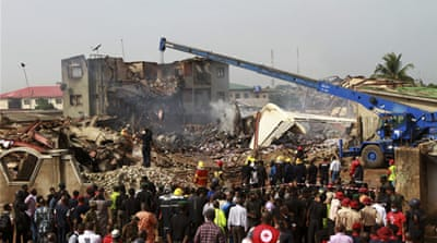 Workers were able to resume the grisly task of digging for charred bodies once the rain stopped on Tuesday [Reuters]