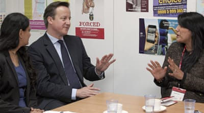 "David Cameron, pictured here with the foreign office's forced marriage unit, called it an ""abhorrent"" practice [Reuters]"