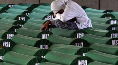 A Bosnian woman cries among 520 caskets in preparation for a mass burrial ceremony [AFP]