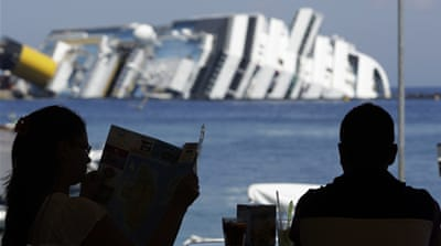 The luxury cruise liner capsized after running aground on a reef near Giglio Porto [Reuters]