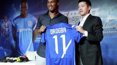 Drogba was given a hero's welcome as he arrived in China to start his contract that will make him one of football's highest-paid players [Reuters]