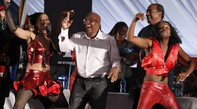 South Africa's Minister of Health, Aaron Motsoaledi, dances during the launching of a HIV testing campaign [Reuters]