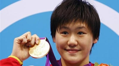 Olympic committee defends China swimmer