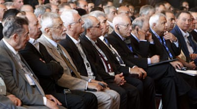 Members of Syria's opposition and Arab and other foreign ministers at a two-day conference in Cairo [Reuters]