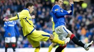 Lee McCulloch, right, is one of the few members of the first team still at Ibrox [EPA]