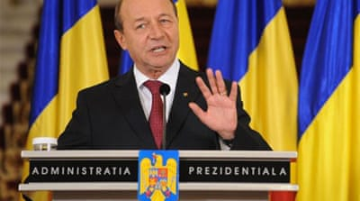 "Basescu accused the ruling USL coalition of trying to ""control all the levers of the state, especially the judiciary"" [AFP]"