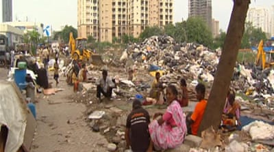 India slum dwellers hustle for a home
