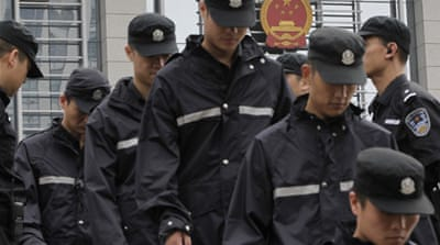China charges policemen in Gu Kailai cover-up