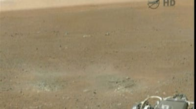 Curiosity beams back historic Mars images