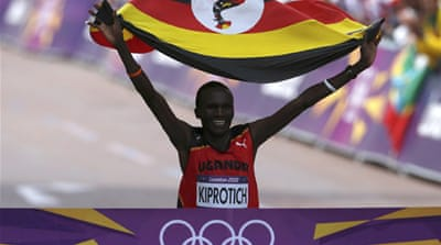 Kiprotich surged ahead in the later stages of the race to capture the first medal for his country in the London Games in a time of 2 hrs 08 mins and 01 seconds [Reuters]