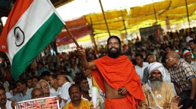 "Baba Ramdev has called his supporters to ""remove the Congress Party and save the nation"" [EPA]"