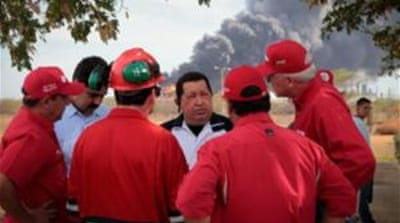 Chavez, centre, has promised an investigation into the explosion at Venezuela's biggest refinery [EPA]