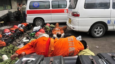 Authorities said one more worker was pulled out alive on Friday but five people remained trapped underground [AFP]