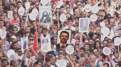 Turkey protesters march in support of Assad