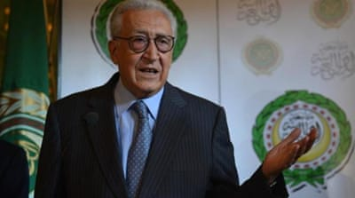 Syria envoy Lakhdar Brahimi, right, and Arab League General Secretary Nabil al-Arabi hold talks in Cairo [AFP]