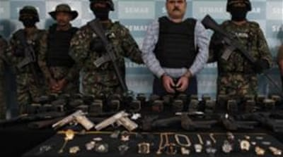 "Guns seized from head of the Gulf Cartel, Jorge ""El Coss"" Eduardo, appeared gilded and studded with jewels [Reuters]"