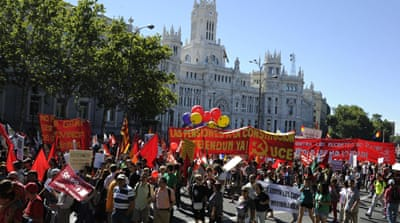Demonstrators gathered in groups along the streets of central  Madrid on Saturday [AFP]
