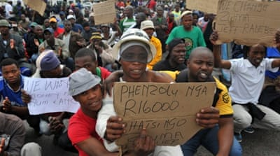 Riot police killed 34 people during a strike in the mining town of Marikana in August 2012 [EPA]