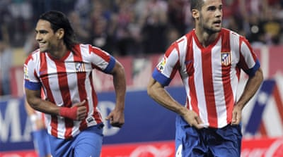 Radamel Falcao scored twice as Atletico Madrid twice came from behind to win 4-2 at Real Betis on Wednesday, moving them only two points behind Barcelona [EPA]