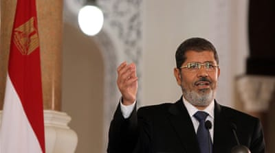 Egyptian President Mohamed Morsi (centre) has called for the creation of a regional group consisting of Turkey, Iran, Saudi Arabia and Egypt to help resolve the Syrian crisis [AFP]