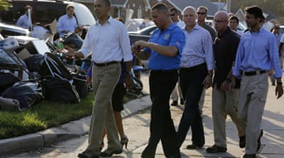 Obama praised the 'enormous faith' of families trying to rebuild their lives after Isaac's damage [Reuters]