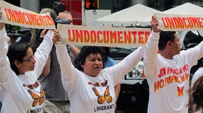 UnDocubus protesters chanted 'No papers, no fear' and played Latin music before police broke up the sit-in, arresting ten activists at the gates of the Democratic National Convention [Charles McDermid/Al Jazeera]