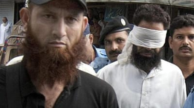 Police say Hafiz Chishti, right, the cleric who accused Masih of burning the Quran, should be sent to court [EPA]